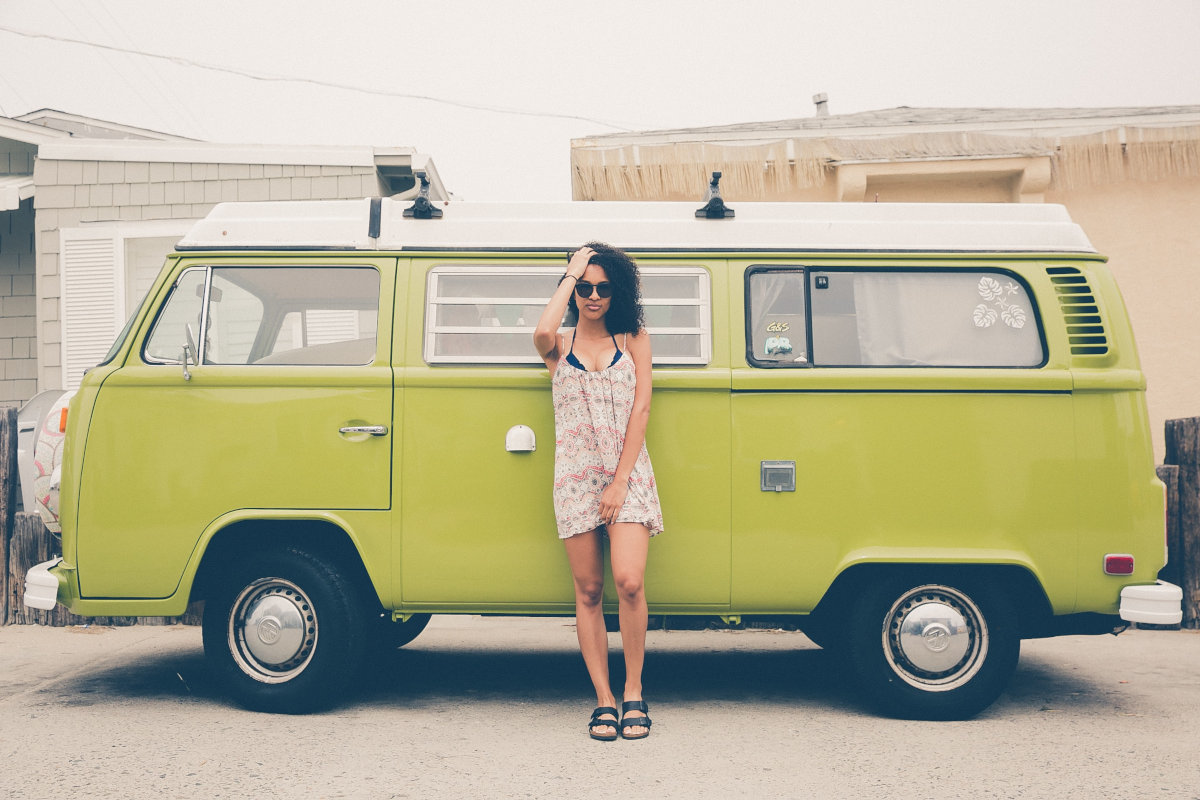 woman before green camper van