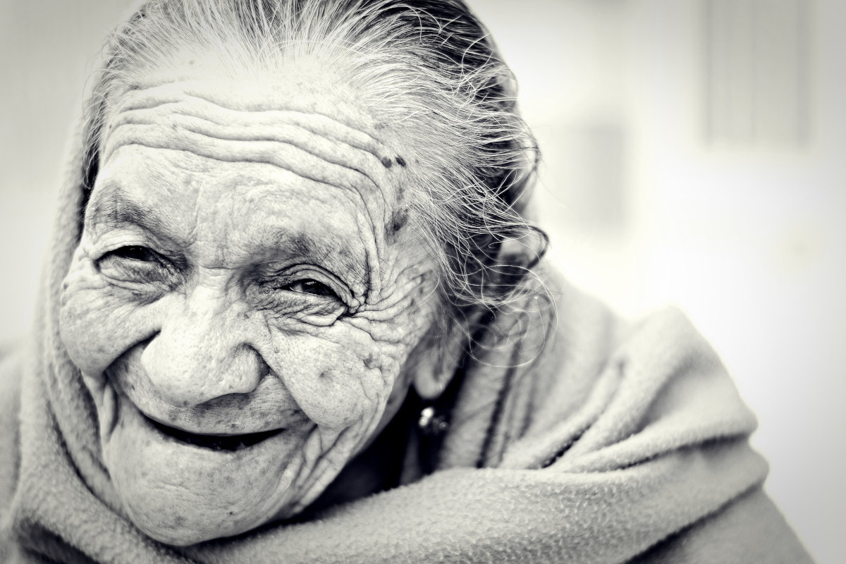 Old woman smiling happily